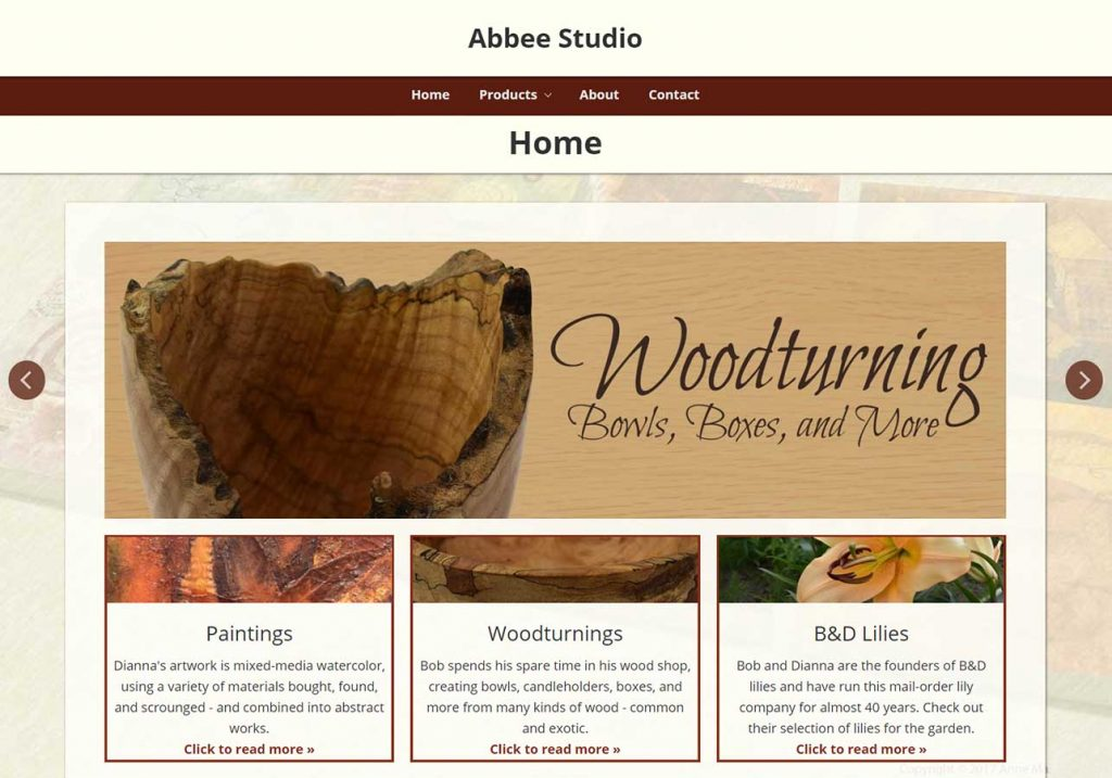 Screenshot of Abbee Studio homepage, created by Wild Song Design. Red, ivory, and black color scheme.